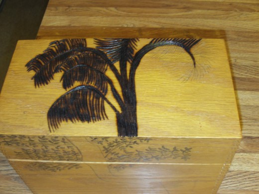 I only have one more palm frond to wood burn on to the tree in this photograph.