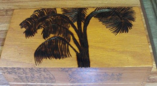 Here I have completed wood burning the palm tree on the top of the box.