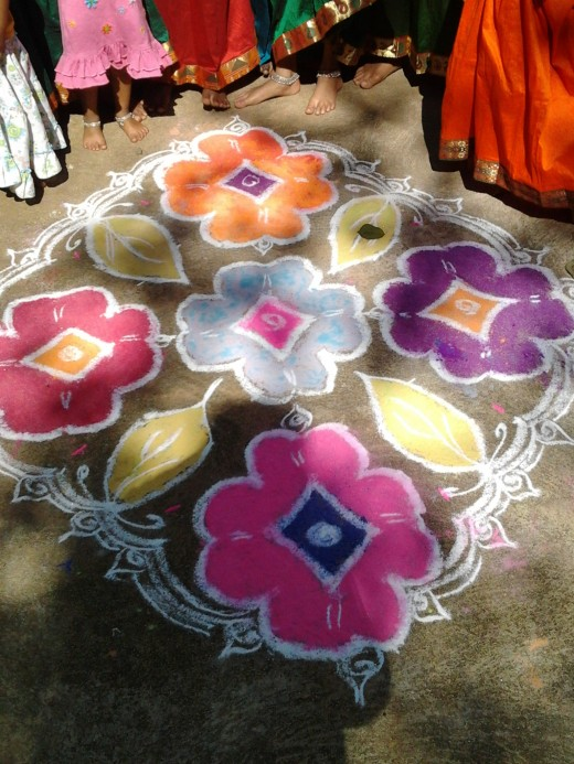 Every day,  floral designs called rangolis are drawn with great precision by the lady of the house in front of her main door to welcome guests. On festival days, large rangolis are drawn with chalk powder, and filled in with colors.