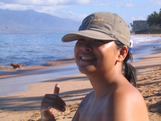 Me giving a shaka on the shore of Kihei, Maui.