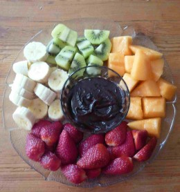 Chopped fruit with dipping sauce.