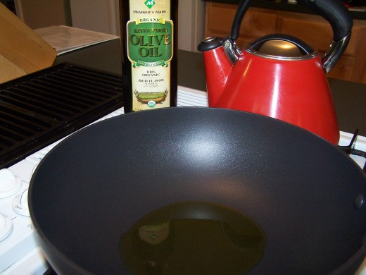Heat olive oil in a heavy pot.
