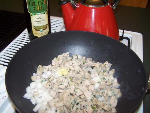 Add the onion, garlic, and sausage to pot.