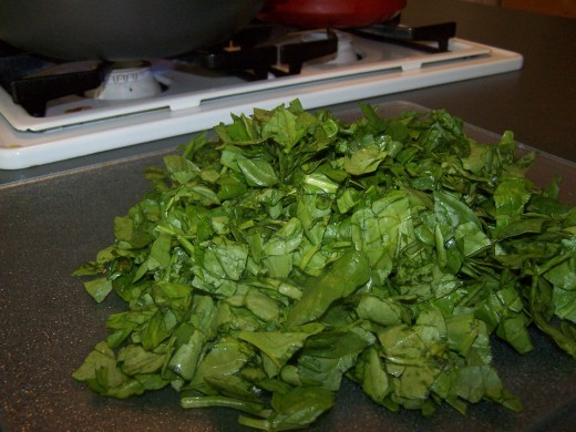 While I am waiting for the stock to come to a boil, I roughly chop the spinach and set aside.