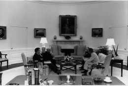 President Ford discusses the evacuation of Saigon with national security advisers Henry Kissinger and Brent Scowcroft during an evening meeting in the White House