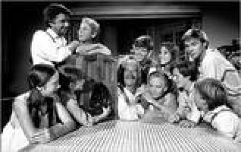 WALTONS SHARE A LAUGH IN THE KITCHEN.