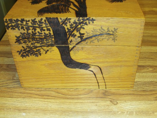 Here I have almost finished wood burning the tree on the box.
