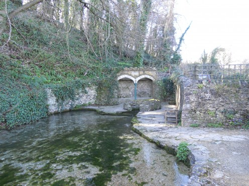 The wishing well, a natural spring rises here and the wishing well is an ancient site of pagan ritual and magic
