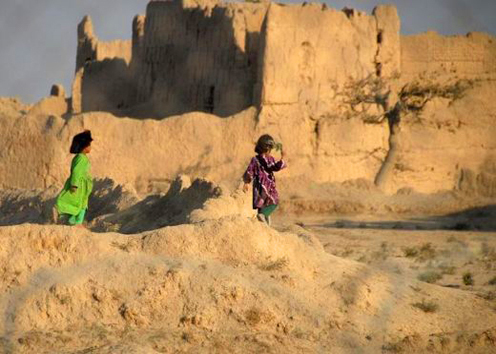 Kids playing around a ruined fort in Afghanistan