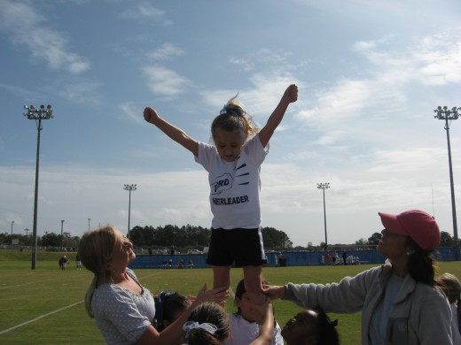 Even simple cheerleading stunts require teamwork.
