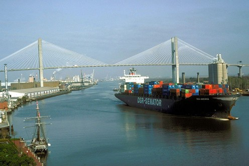 Port of Savannah and Talmadge Memorial Bridge. Ship is sailing down the Savannah River past the Savannah Historic District.