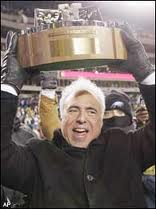 Jeffrey Lurie holds up the N.F.C. Conference Championship trophy.