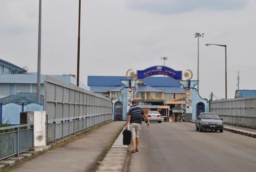 The border Thailand and Malaysia.  Walking across the Harmony Bridge.