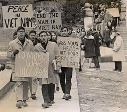 Student protesters marching down Langdon Street at the University of Wisconsin-Madison during the Vietnam War era.