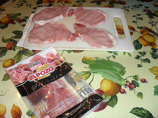 The assembled ingredients - pork steaks, jamón Serrano and large, fresh sage leaves.