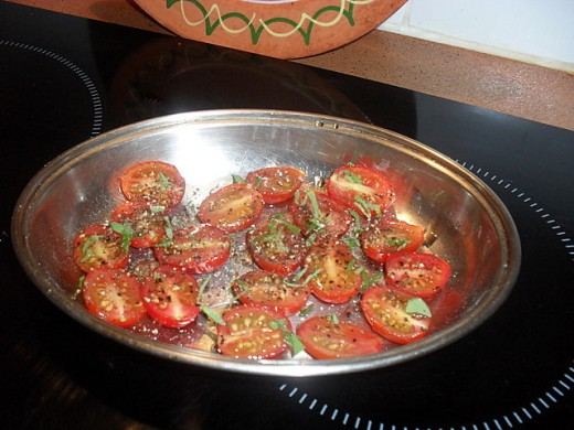 The tartness of the tomatoes - here sprinkled with fresh basil - goes beautifully with the sweet sauce. Just bake them slowly in a medium hot oven until they are soft and juicy.