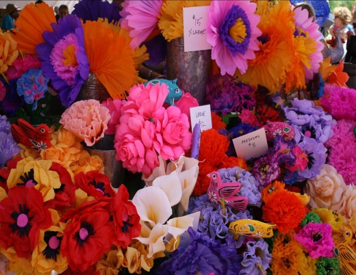 These hand made tissue flowers were photographed at an outdoor market.