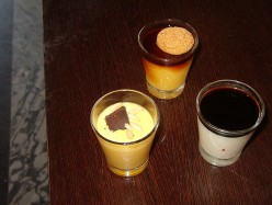 Three desserts  with balsamic vinegar: clockwise from left, panna cotta, zabaglione, and crème caramel.