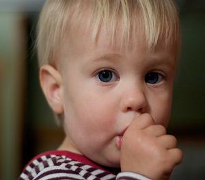 Little boy sucking his thumb.