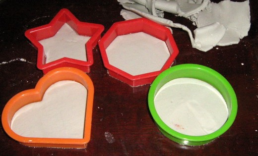 Take the newly made clay shapes away from the moulds