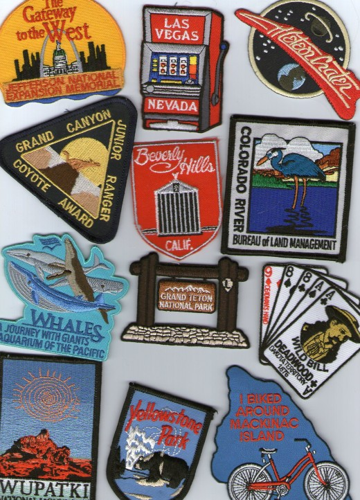Various patches from Grand Canyon, Aquarium of the Pacific in Long Beach, Deadwood, South Dakota, Arizona's Meteor Crater, Mackinac Island and Las Vegas.