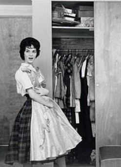HEY, THIS STILL FITS! SAYS AN EXCITED HOUSE WIFE OF THE 50'S AFTER HER HUSBAND SAYS HE IS TAKING HER TO DINNER. THEN DANCING.