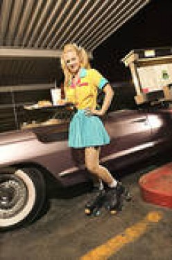 YOUR ORDER, SIR, SAYS THIS PRETTY CAR HOP, WHICH IN SOME OUTDOOR EATING ESTABLISHMENTS IN 2011, SUCH AS SONIC, THEY STILL HAVE CAR HOPS.