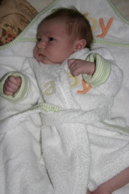 Baby in a robe after bathtime.