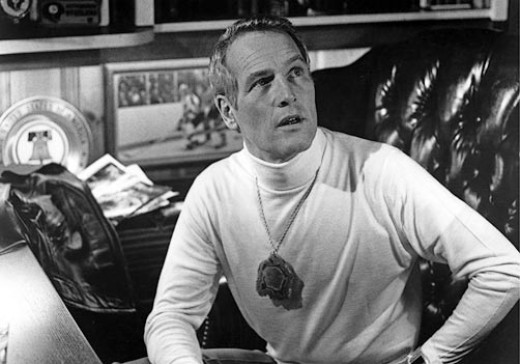 """Newman tries to control his team and his laughter in """"Slapshot."""""""