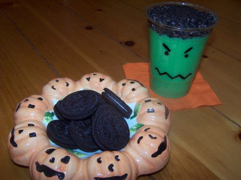 Monster Pudding Cups: Making and decorating Halloween pudding cups is a fun way for kids to help out in the kitchen.