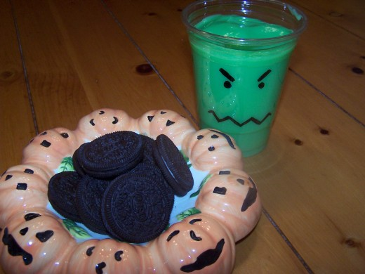 Add green-colored vanilla pudding to the Halloween monster cups.