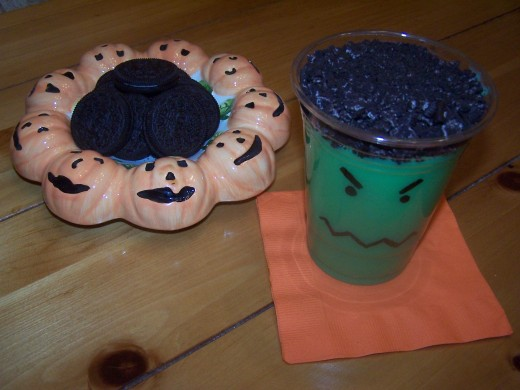 "Add a layer of crushed Oreo cookie on top of the green pudding to make ""monster hair."""