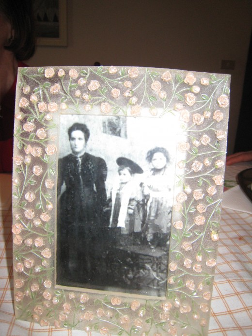 Original photograph of my grandfather as a boy (in the middle) with his mother and older sister.