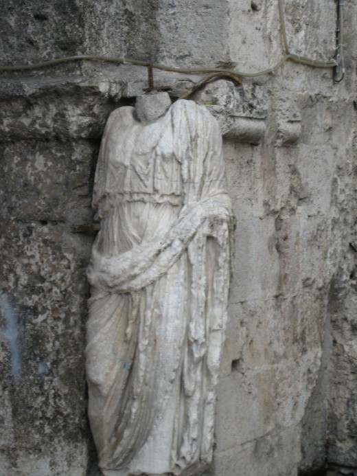 Original statue carved on the gates of the entrance to the city of Isernia, Italy.