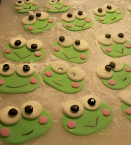 The Keroppi heads. I assembled these first. All made from marshmallow fondant.  And lots of powdered sugar to keep from sticking to my board.