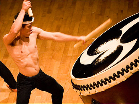 """A graduate beating his drum in the group, """"Kodo."""""""