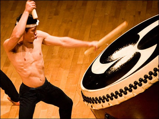 "A graduate beating his drum in the group, ""Kodo."""