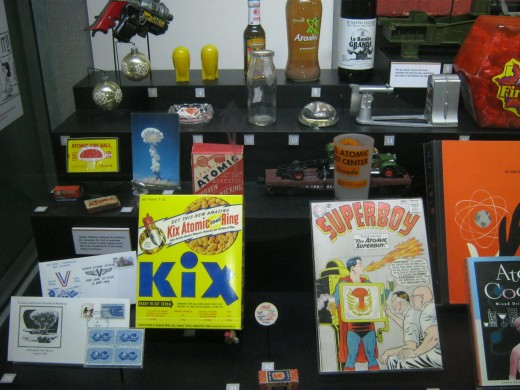 """Some of the """"pop culture"""" of the time, ranging in variety from a """"Kix"""" cereal box to """"atomic fireball"""" candy."""