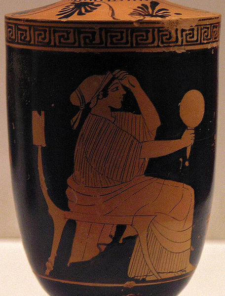 An image from ancient Greece of a woman holding a mirror.
