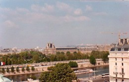 From my window: The Tuilleries gardens, the Louvre, and the busy Seine.
