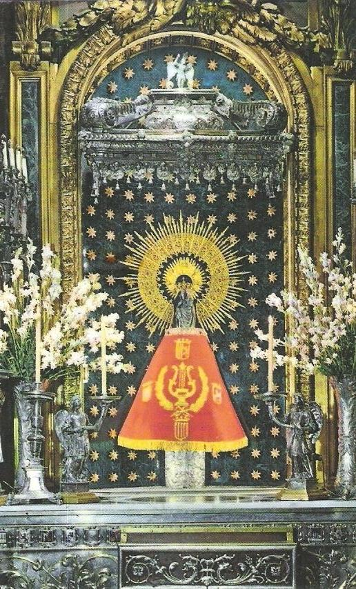 Our Lady's Pillar adorned by grateful Spaniards with precious stones and gilded fabrics.  The golden halo is also an adornment.