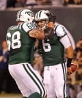 The Jets' Matt Slauson congratulates Mark Sanchez after his touchdown run in the 2nd quarter.