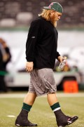 New York Jets center Nick Mangold walks out with both ankles wrapped for pre game warmups
