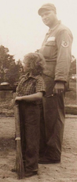 This is when I was on the farm toting my broom.  The broom was handmade by my grandmother. All rights reserved by ladybluewriter. The man in the picture was my dad.