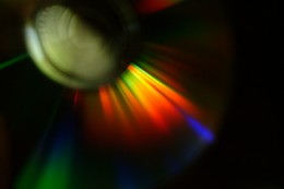 CD with colorful light reflection on surface