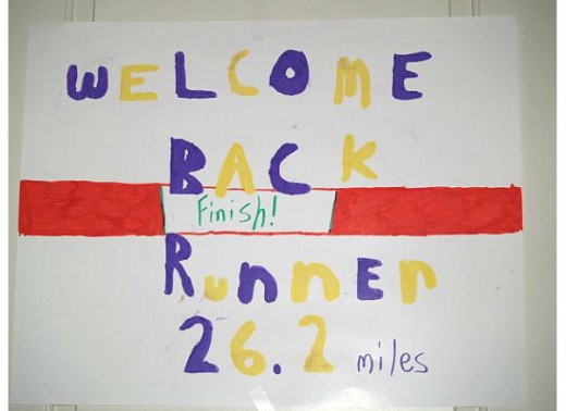 My kids made Welcome Home signs - even our next door neighbor helped out!