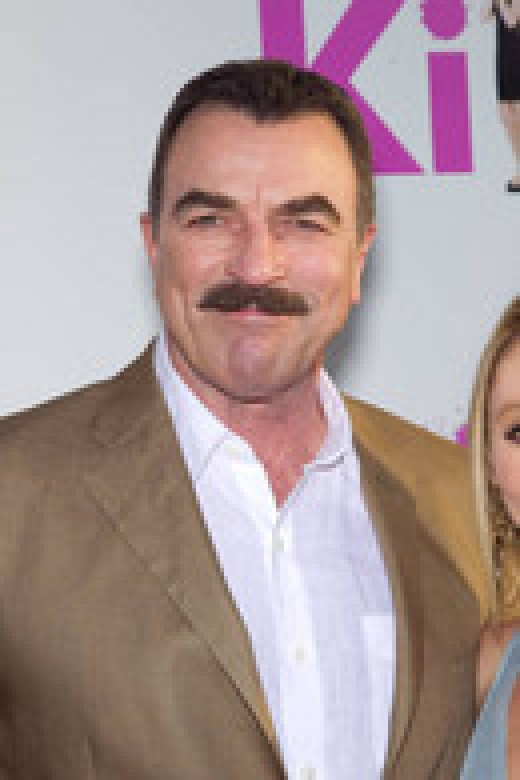 TOM SELLECK with moustache. And looking very tired.