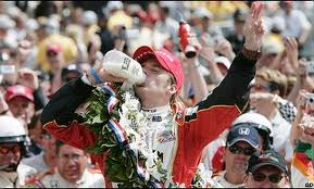 Wheldon celebrating his first Indy 500 triumph in 2005