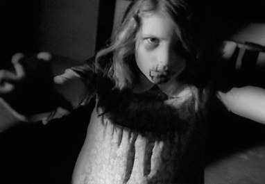 Is this girl a zombie, or is she high on Marijuana and crazy from listening to the Beatles' White Album? The film illustrates such ridiculous thinking.