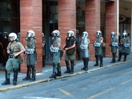 Men of the greek riot police (MAT) on standby for crackdown of an anarchist solidarity demonstration
